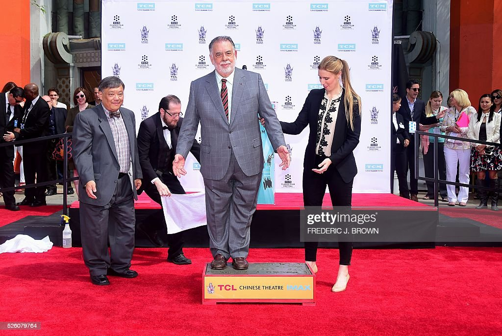 Director Francis Ford Coppola stands on the cement at his Hand and Footprint Ceremony in front of the TCL theater in Hollywood, California on April 29, 2016. The US film director was honored as part of the 2016 TCM Classic Film Festival. / AFP / FREDERIC