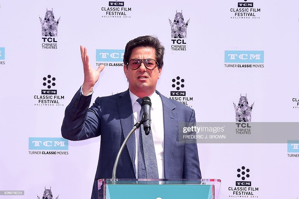 Director Francis Ford Coppola's son Roman speaks at his father's Hand and Footprint Ceremony in front of the TCL theater in Hollywood, California on April 29, 2016. The US film director was honored as part of the 2016 TCM Classic Film Festival. / AFP / FREDERIC