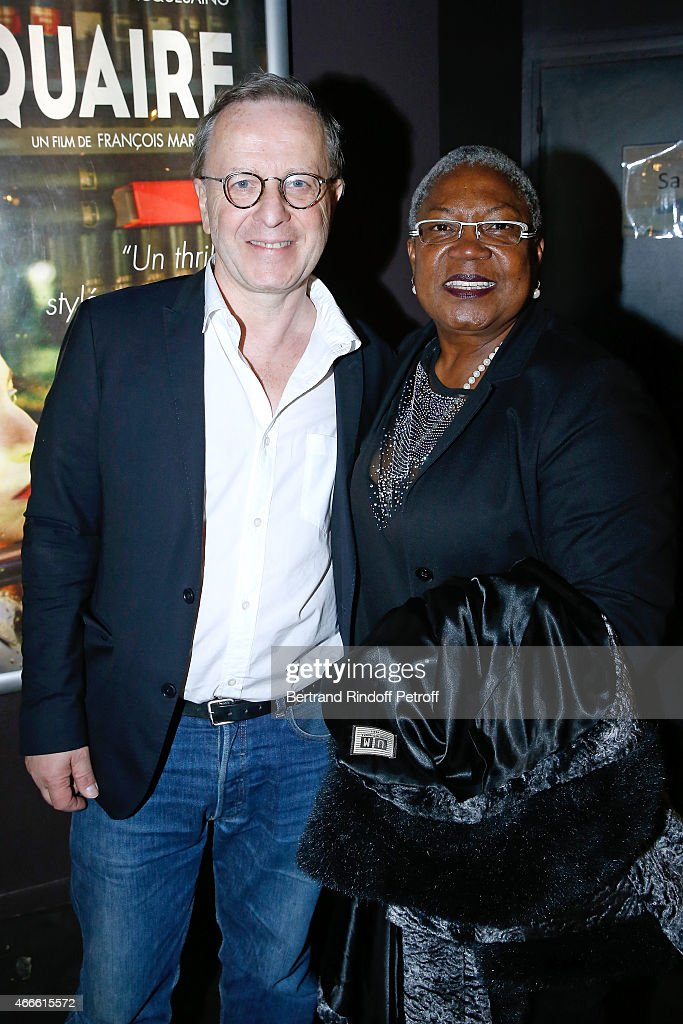 Director Francois Margolin and Actress <a gi-track='captionPersonalityLinkClicked' href=/galleries/search?phrase=Firmine+Richard&family=editorial&specificpeople=615504 ng-click='$event.stopPropagation()'>Firmine Richard</a> attend the 'L'Antiquaire' Paris Premiere at Le Cinema des Cineastes on March 17, 2015 in Paris, France.