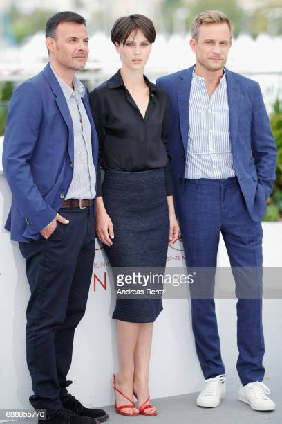 Director Francois Ozon actress Marine Vacth and actor Jeremie Renier attend the 'Amant Double ' Photocall during the 70th annual Cannes Film Festival...