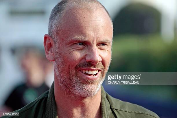 US director Fredrik Bond poses on the red carpet for a photocall before the screening of his film 'The Necessary Death of Charlie Countryman' on...