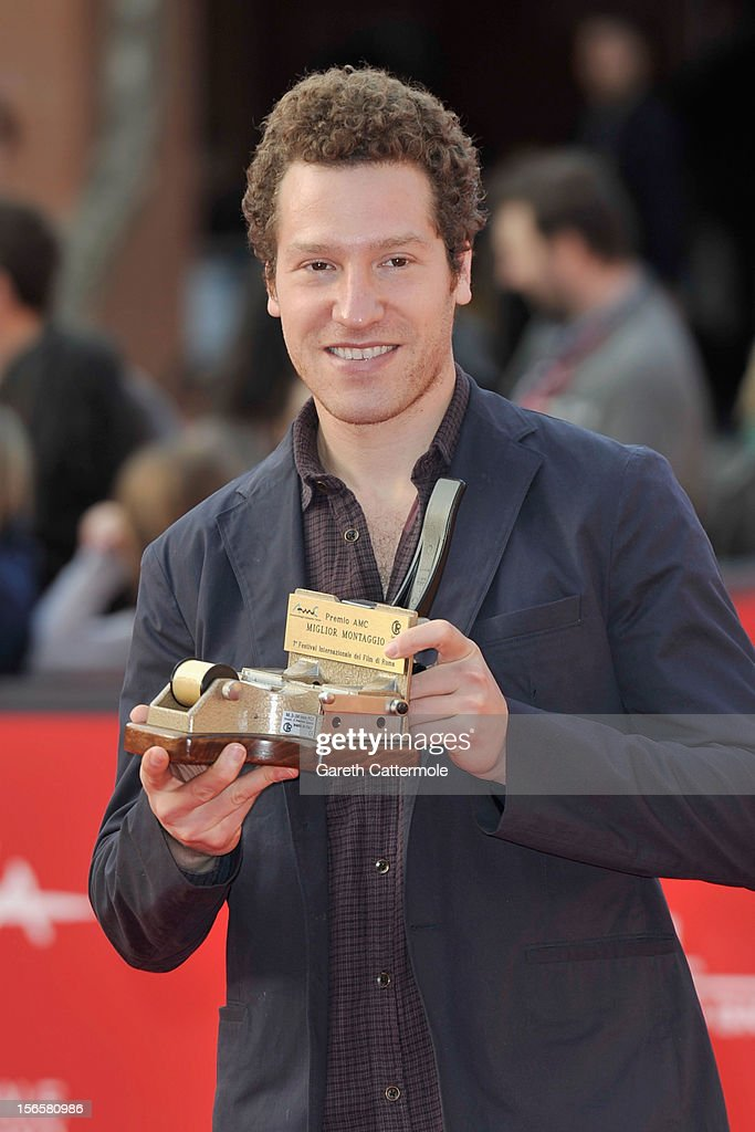 Director Gabe Polsky poses with the AMC Award for Best Editing on behalf of Hughes Winborne and Fabienne Rawley for 'The Motel Life'' as he attends the Collateral Awards Red Carpet photocall during the 7th Rome Film Festival at Auditorium Parco Della Musica on November 17, 2012 in Rome, Italy.