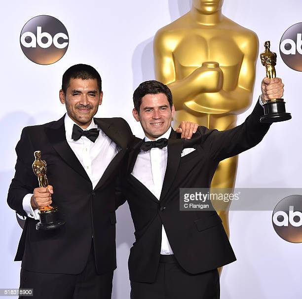 Director Gabriel Osorio Vargas and producer Pato Escala Pierart winners of the Best Animated Short award for 'Bear Story' pose in the press room...