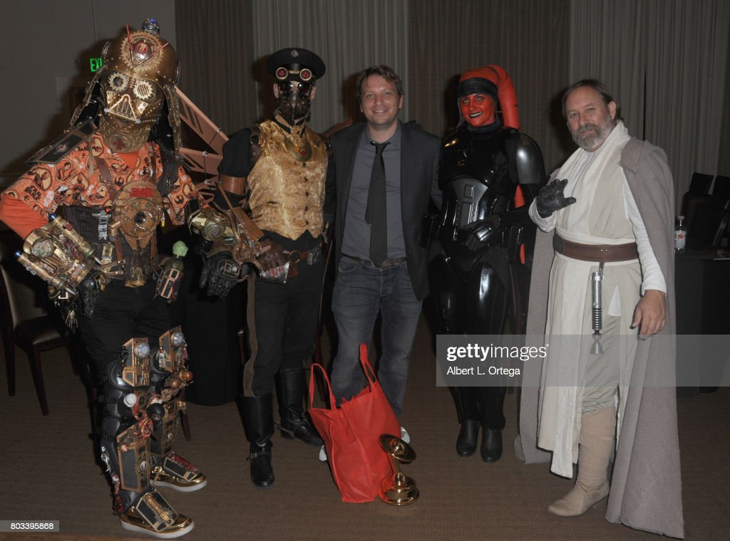 Director Gareth Edward (center) poses with Star Wars cosplayers Christopher Canole, Nathan Seekerman, Michele Headley and Shawn Crosby at the 43rd Annual Saturn Awards - After Party held at The Castaway on June 28, 2017 in Burbank, California.