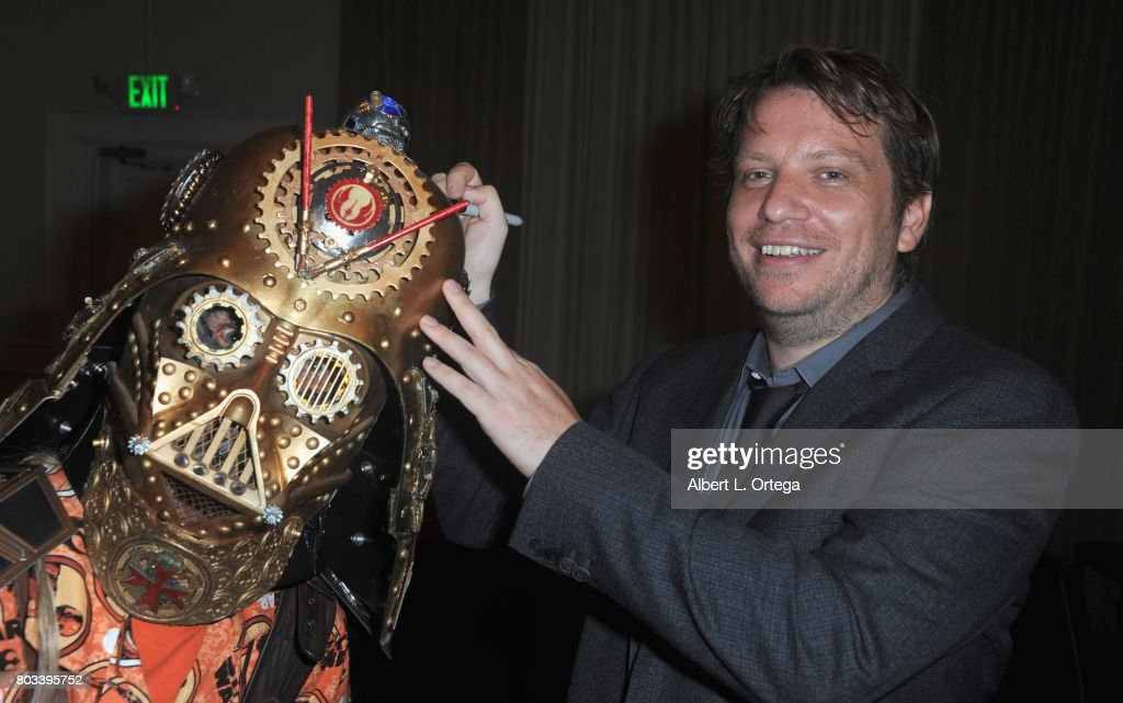 Director Gareth Edwards autographs the helmet of Christopher Canole aka Dude Vader at the 43rd Annual Saturn Awards - After Party held at The Castaway on June 28, 2017 in Burbank, California.