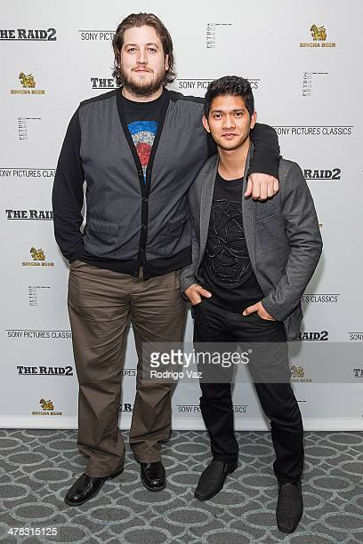 Director Gareth Evans and actor Iko Uwais attend 'The Raid 2' Los Angeles Premiere arrivals at Harmony Gold Theatre on March 12 2014 in Los Angeles...