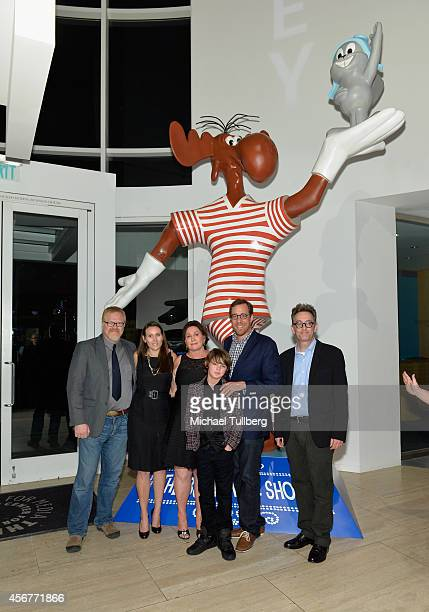 Director Gary Trousdale guest Bullwinkle Studios President Tiffany Ward actor Max Charles director Rob Minkoff and actor Tom Kenny pose in front of a...
