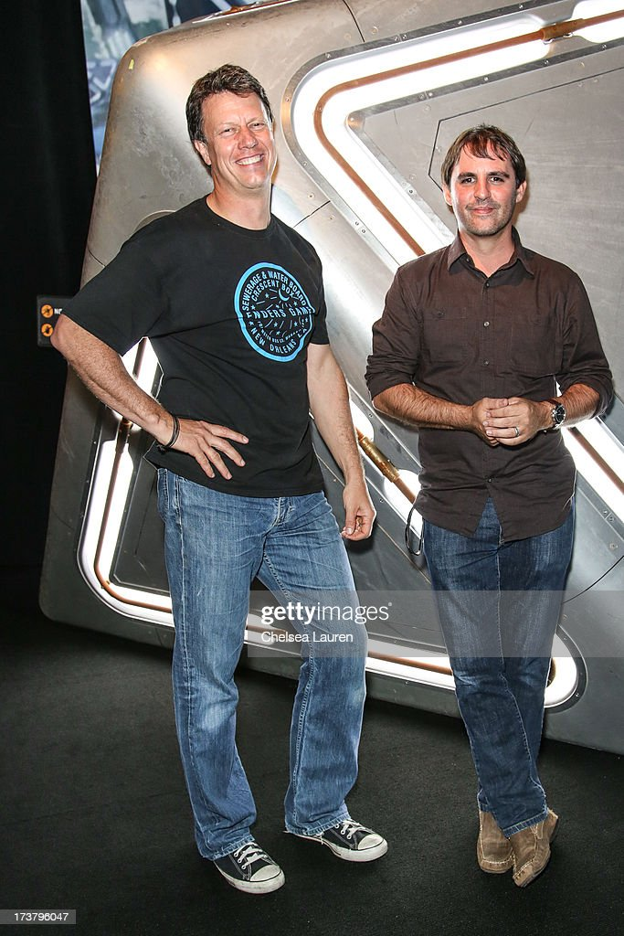 Director <a gi-track='captionPersonalityLinkClicked' href=/galleries/search?phrase=Gavin+Hood&family=editorial&specificpeople=667949 ng-click='$event.stopPropagation()'>Gavin Hood</a> (L) and producer Roberto Orci attend the 'Ender's Game' exclusive fan experience press prevew night on July 17, 2013 in San Diego, California.