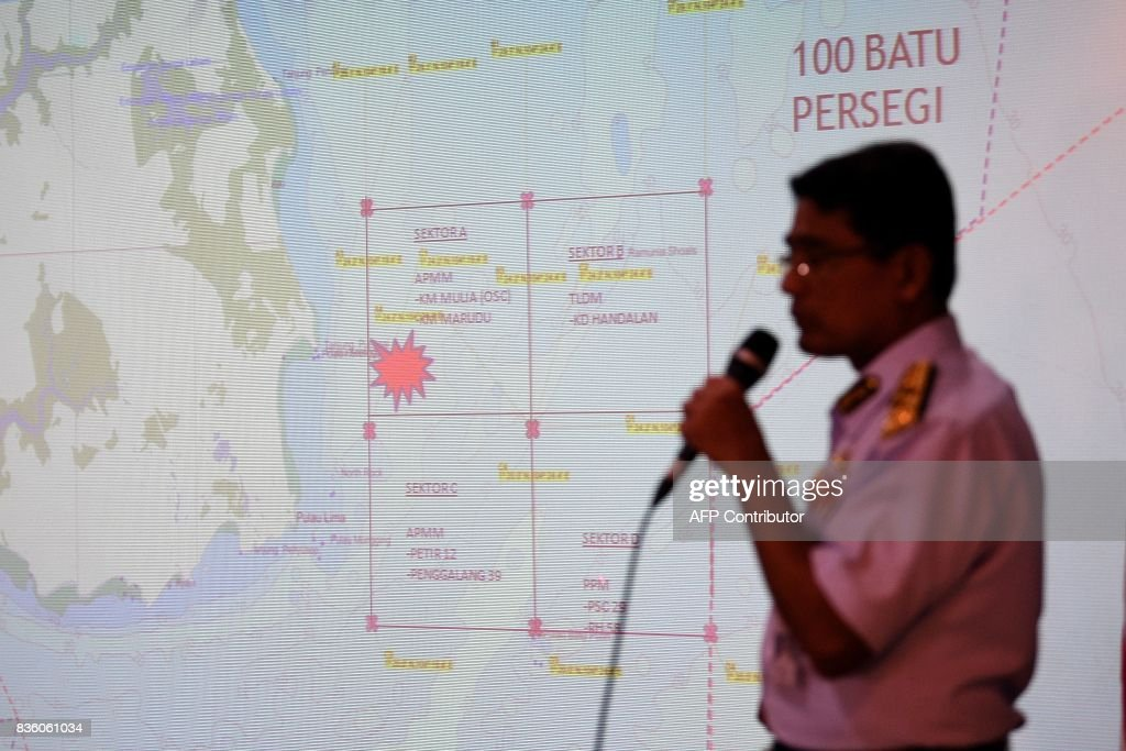 Director General Malaysian Maritime Enforcement Agency (MMEA) Zulkifili Abu Bakar addresses members of the media at the Malaysian Maritime Headquarters in Putrajaya on August 21, 2017, after the guided-missile destroyer USS John S. McCain collided with an oil tanker east of Singapore. Ten US sailors were missing and five injured early on August 21 after their destroyer collided with a tanker east of Singapore, the second accident involving an American warship in two months. /