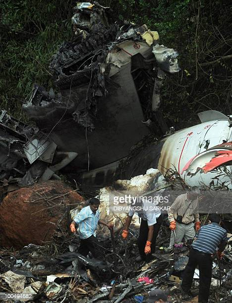 Director General of Civil Aviation officials search for the 'black box' at the crash site of the doomed Air India Express flight 812 in Mangalore on...