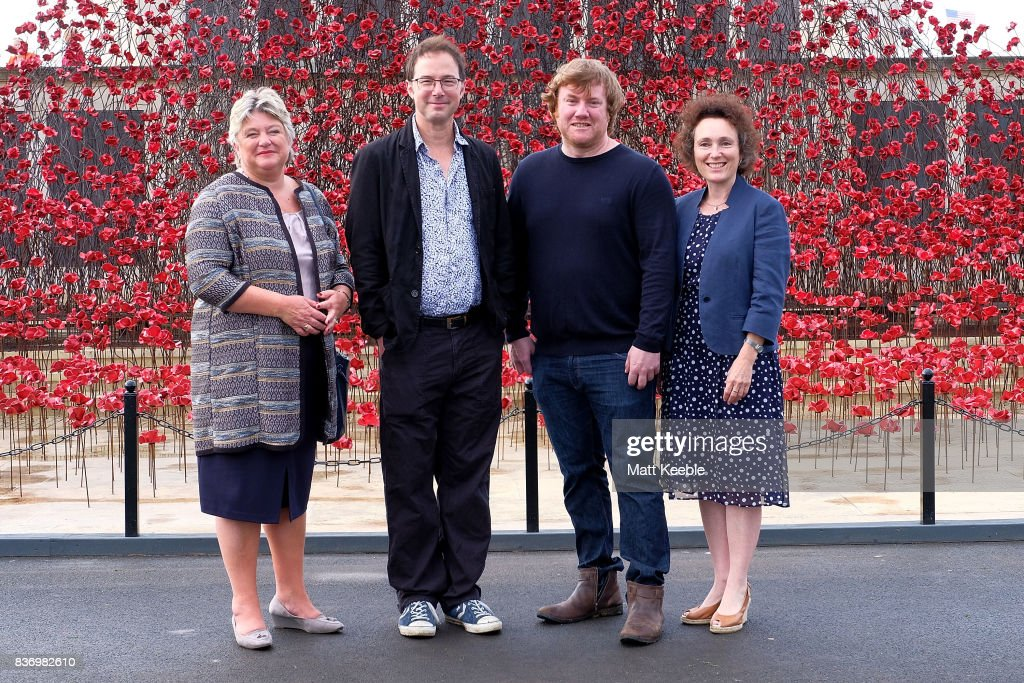 Director General of CWGC Victoria Wallace, Designer Tom Piper, Artist Paul Cummins and Director of 14-18 NOW Jenny Waldman attendi the poppy sculpture 'Wave' opening at the CWGC Naval Memorial, as part of a UK wide tour organised by 14-18 NOW on August 22, 2017 in Plymouth, England.
