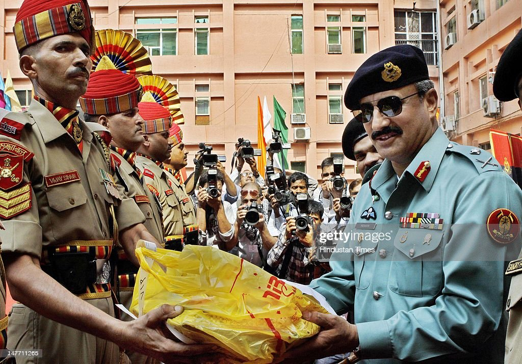 Director General of Pakistani Rangers (Sindh) Major General Rizwan Akhtar (R) presents gifts to BSF personnel after inspecting guard of Honor during BSF-Pakistan Rangers bi-annual meeting 2012 on July 2, 2012 in New Delhi, India. Maj Gen Rizwan Akhtar is leading 18-member high-level delegation of Pakistan Rangers and Interior Ministry on 5-day border level talks with BSF.