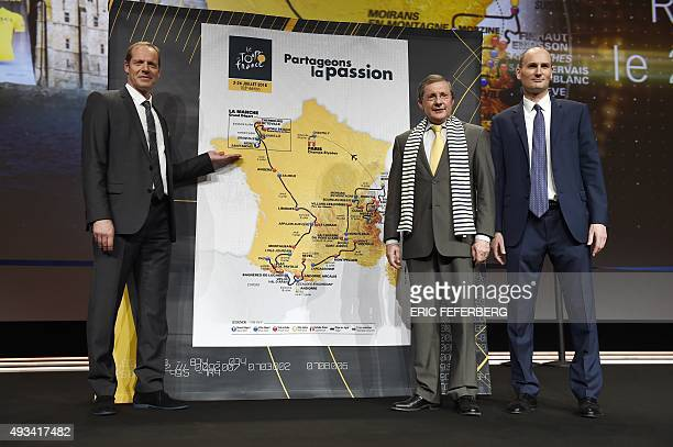 Director general of the Tour de France Christian Prudhomme president of the departemental council of La Manche in the Lower Normandy region Philippe...