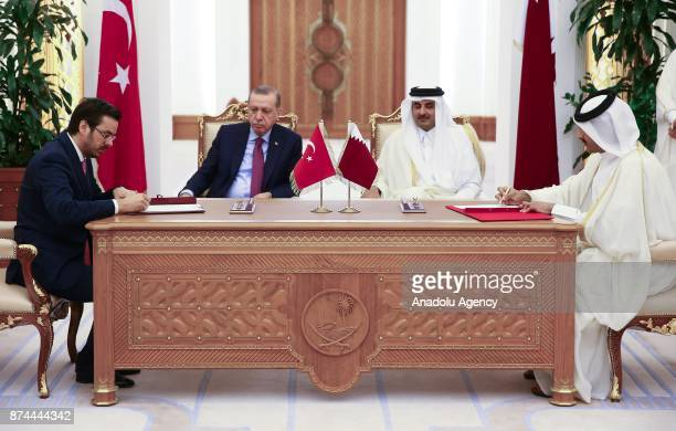 Director General of the Turkish Radio and Television Corporation Ibrahim Eren signs an agreement on behalf of Turkey as he is flanked by President of...