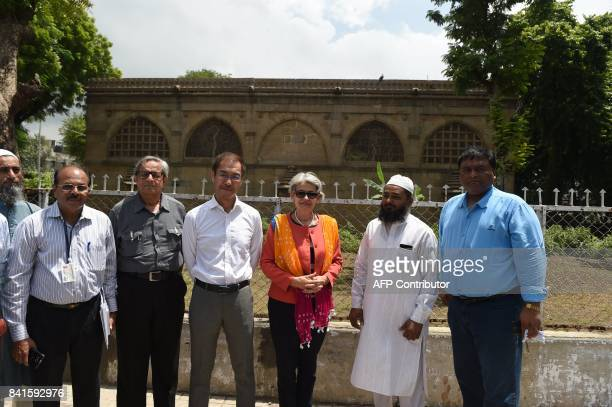 Director General of UNESCO Irina Bokova UNESCO's New Delhi Director Shigeru Aoyagi and Professor Rabindra Vasavada pose for a picture with others...