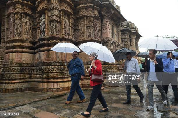 Director General of UNESCO Irina Bokova walks with Senior Archaeologist of the Archaeological Survey of India Anil Tiwari during their visit at the...