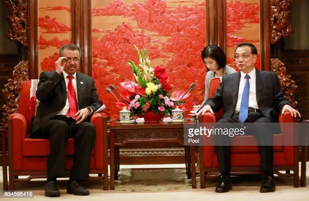 Director general of World Health Organisation Tedros Adhanom Ghebreyesus adjusts his glasses as he meets with Chinese Premier Li Keqiang at...