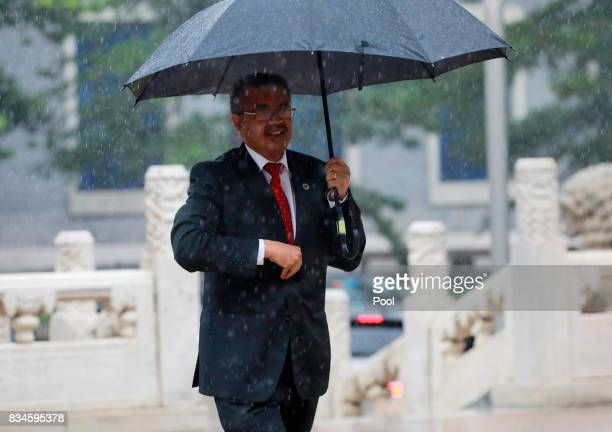 Director general of World Health Organisation Tedros Adhanom Ghebreyesus arrives for his meeting with Chinese Premier Li Keqiang in the rain at...