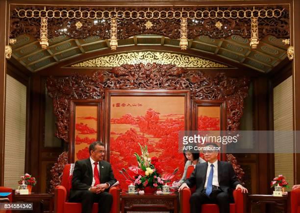 Director general of World Health Organisation Tedros Adhanom Ghebreyesus chats with Chinese Premier Li Keqiang during their meeting at Zhongnanhai...
