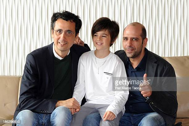 Director Gennaro Nunziante Actor Robert Dancs and Checco Zalone attend the 'Sole A Catinelle' photocall on October 30 2013 in Milan Italy