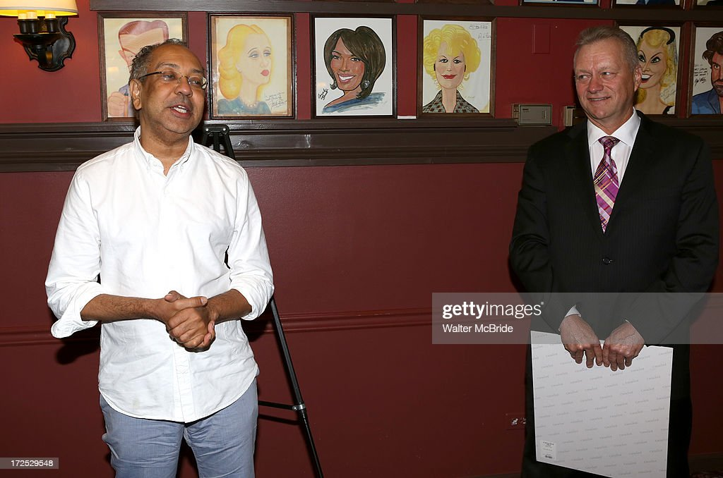 Director George C. Wolfe and Max Klimavicius attend Courtney B. Vance's Caricature Unveiling at Sardi's on July 2, 2013 in New York City.