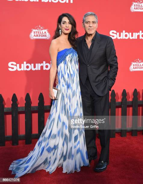 Director George Clooney and wife Amal Clooney arrive at the premiere of Paramount Pictures' 'Suburbicon' at Regency Village Theatre on October 22...