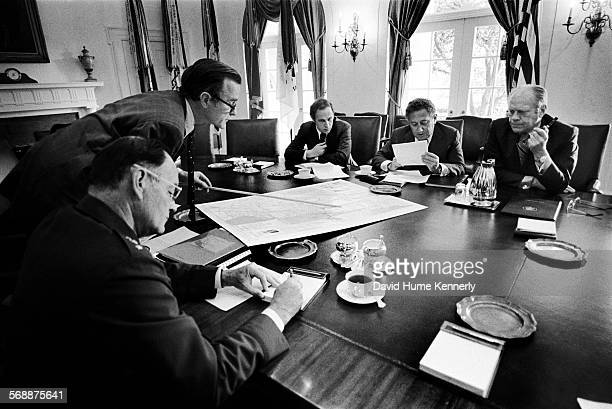 Director George HW Bush leads a National Security Council meeting to discuss the evacuation from Beirut of 1400 Americans still remaining in the...