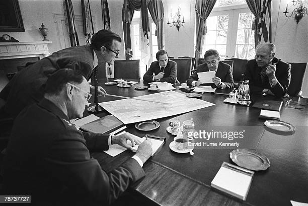 CIA Director George HW Bush leads a National Security Council meeting to discuss the evacuation from Beirut of 1400 Americans still remaining in the...