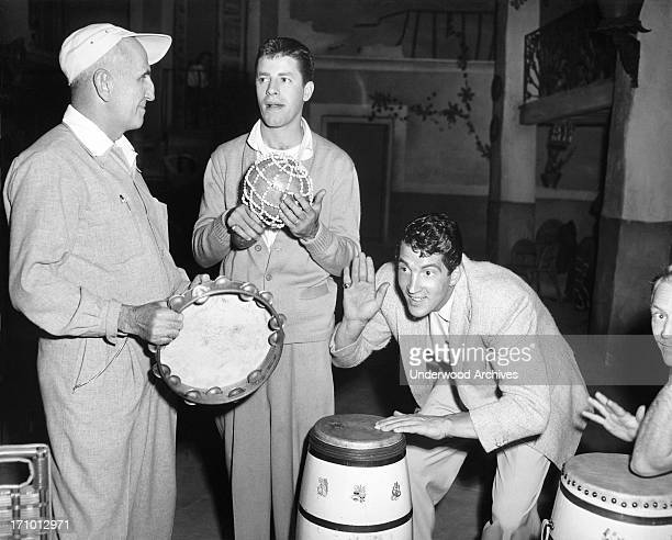 Director George Marshall gives instructions to Jerry Lewis and Dean Martin on how to rattle a golfing opponent during the filmiing of the movie...