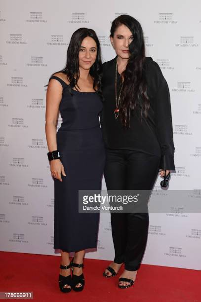 Director Giada Colagrande and performance artist Marina Abramovic attend 'The Abramovic Method' Cocktail Party during The 70th Venice International...
