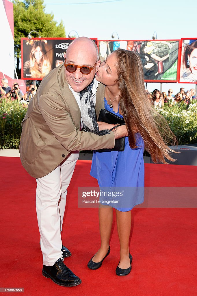 Director Gianfranco Rosi (L) and a guest attend the 'Sacro Gra' Premiere during the 70th Venice International Film Festival at the Palazzo del Cinema on September 5, 2013 in Venice, Italy.