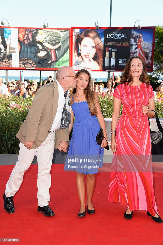 Director Gianfranco Rosi (L) and guests attend the 'Sacro Gra' Premiere during the 70th Venice International Film Festival at the Palazzo del Cinema on September 5, 2013 in Venice, Italy.