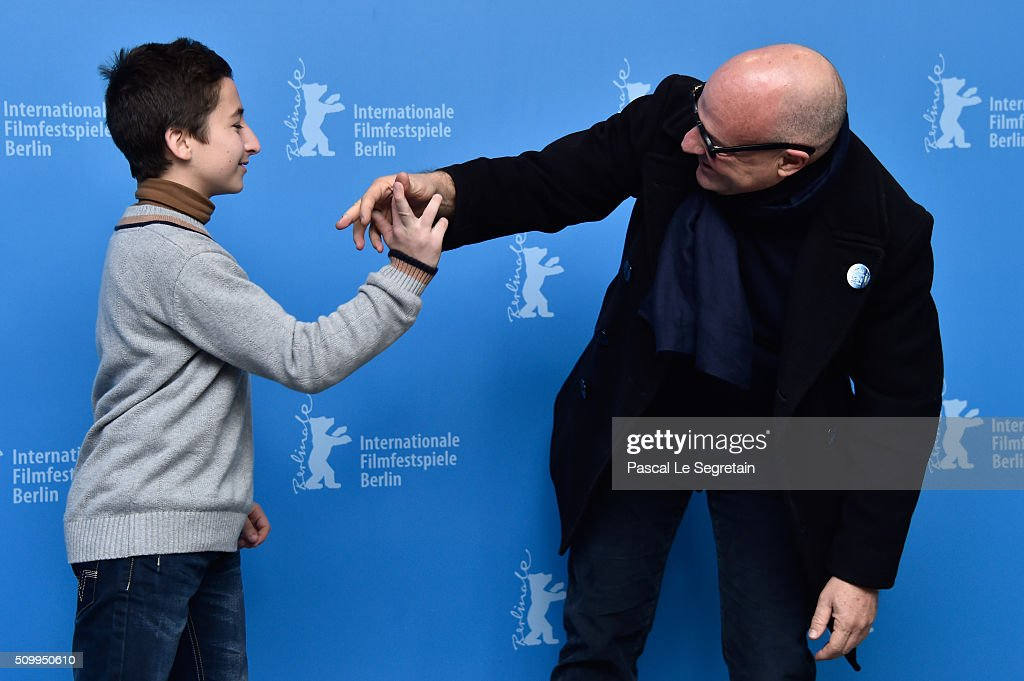 Director Gianfranco Rosi (R) and protagonist Samuele Pucillo attend the 'Fire at Sea' (Fuocoammare) photo call during the 66th Berlinale International Film Festival Berlin at Grand Hyatt Hotel on February 13, 2016 in Berlin, Germany.