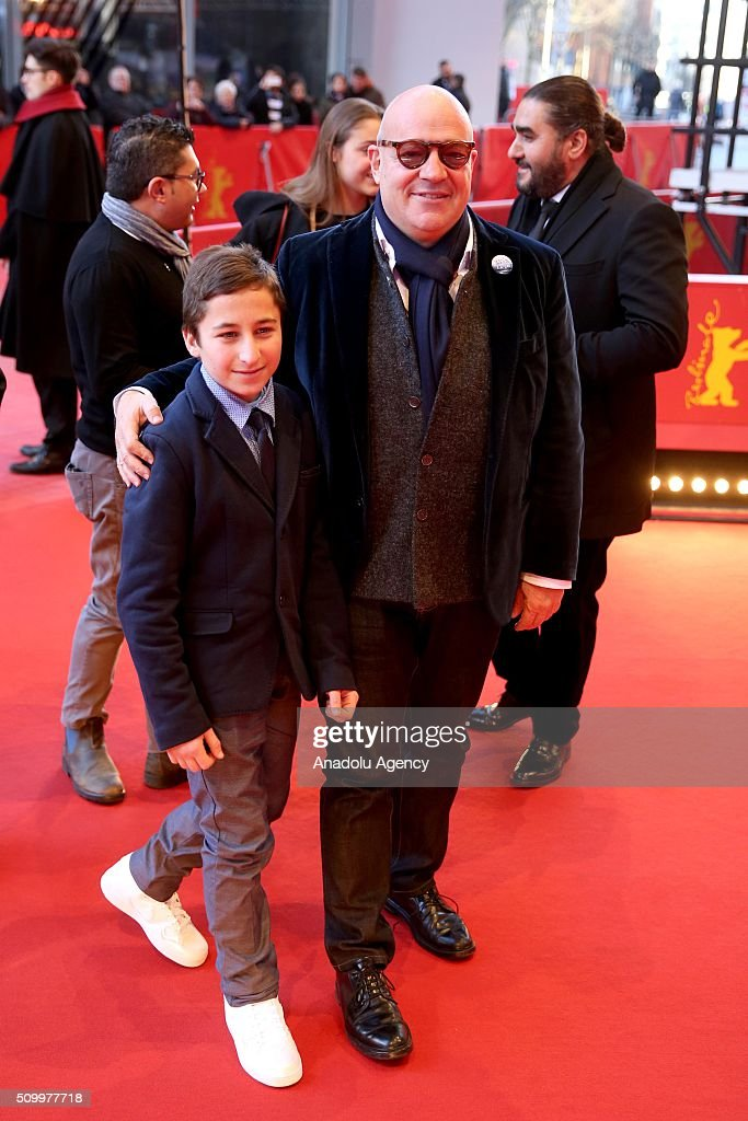 Director Gianfranco Rosi (R) and protagonist Samuele Pucillo attend the 'Fire at Sea' (Fuocoammare) premiere during the 66th Berlinale International Film Festival Berlin at Berlinale Palace on February 13, 2016 in Berlin, Germany.