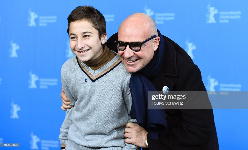 Director Gianfranco Rosi (R) and protagonist Samuele Pucillo pose during a photo call for the film 'Fuocoammare' (Fire At Sea) in competition at the 66th Berlinale Film Festival in Berlin on February 13, 2016. / AFP / TOBIAS SCHWARZ
