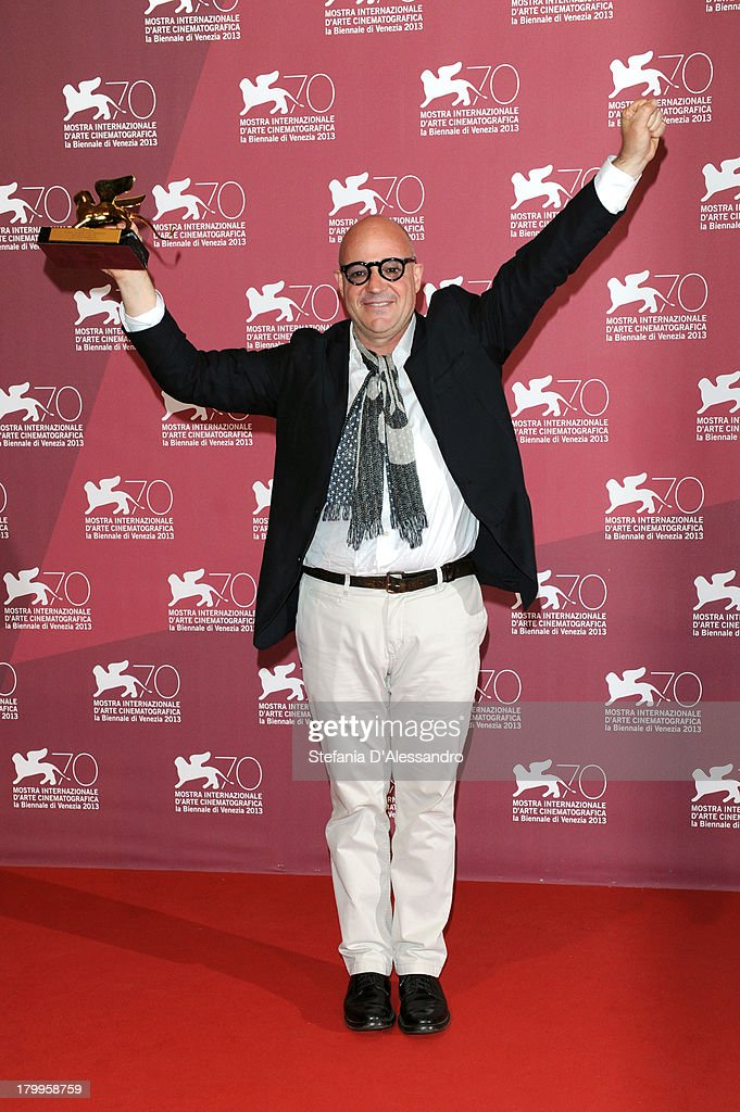Director Gianfranco Rosi attends Award Winners Photocall during the 70th Venice International Film Festival at Palazzo del Casino on September 7, 2013 in Venice, Italy.