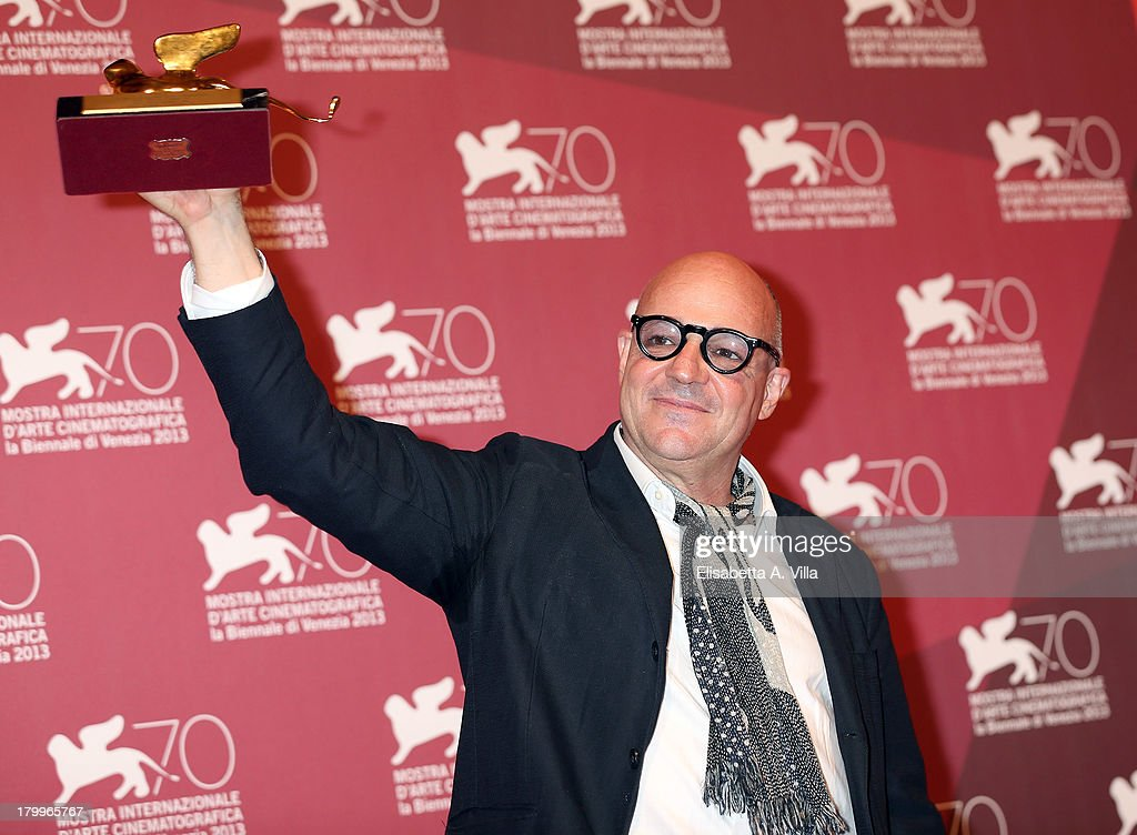 Director Gianfranco Rosi poses with the Golden Lion award for the Best Film for his movie 'Sacro Gra' at the Award Winners Photocall during the 70th Venice International Film Festival at Palazzo del Casino on September 7, 2013 in Venice, Italy.