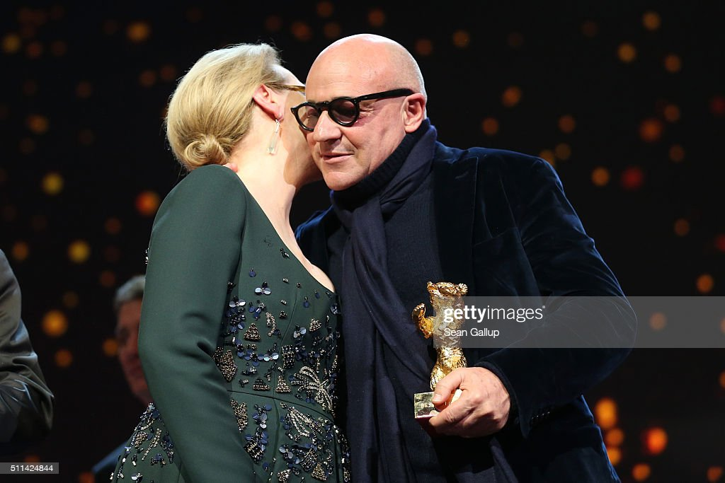 Director Gianfranco Rosi winner of the Golden Bear for Best Film for his movie 'Fuocoammare' receives his award from jury president Meryl Streep on...