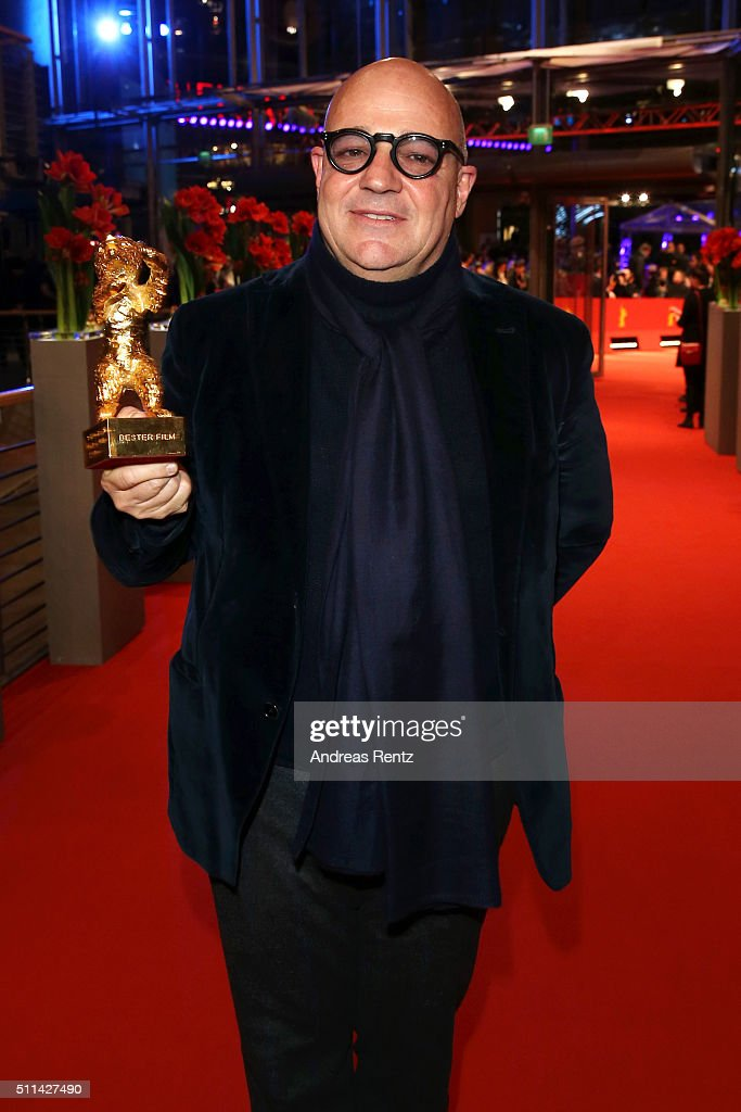 Director <a gi-track='captionPersonalityLinkClicked' href=/galleries/search?phrase=Gianfranco+Rosi+-+Film+Director&family=editorial&specificpeople=11450350 ng-click='$event.stopPropagation()'>Gianfranco Rosi</a>, winner of the Golden Bear for Best Film for his movie 'Fuocoammare', poses with his award after the closing ceremony of the 66th Berlinale International Film Festival on February 20, 2016 in Berlin, Germany.