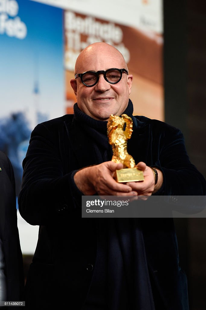 Director <a gi-track='captionPersonalityLinkClicked' href=/galleries/search?phrase=Gianfranco+Rosi+-+Film+Director&family=editorial&specificpeople=11450350 ng-click='$event.stopPropagation()'>Gianfranco Rosi</a>, winner of the Golden Bear for Best Film for his movie 'Fuocoammare', poses with his award at the award winners press conference of the 66th Berlinale International Film Festival on February 20, 2016 in Berlin, Germany.
