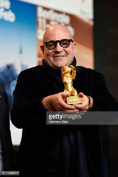 Director Gianfranco Rosi winner of the Golden Bear for Best Film for his movie 'Fuocoammare' poses with his award at the award winners press...
