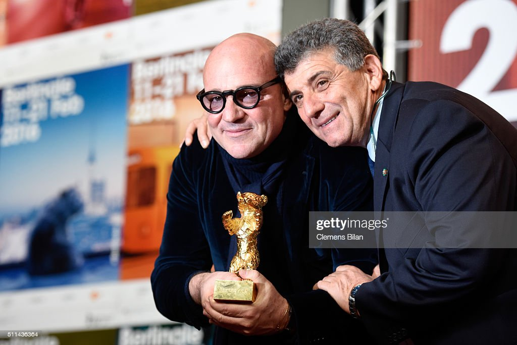Director Gianfranco Rosi winner of the Golden Bear for Best Film for his movie 'Fuocoammare' poses with his award and protagonist Pietro Bartolo at...