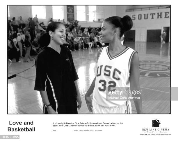 Director Gina PrinceBythewood and actress Sanaa Lathan on set of the New Line Cinema movie ' Love Basketball ' circa 2000