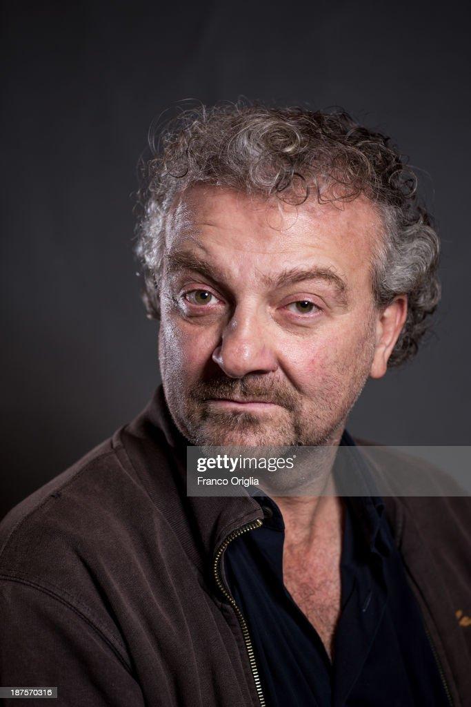 Director Giovanni Veronesi poses on a portrait session for his film 'l'Ultima Ruota del Carro' during The 8th Rome Film Festival at Auditorium Parco...