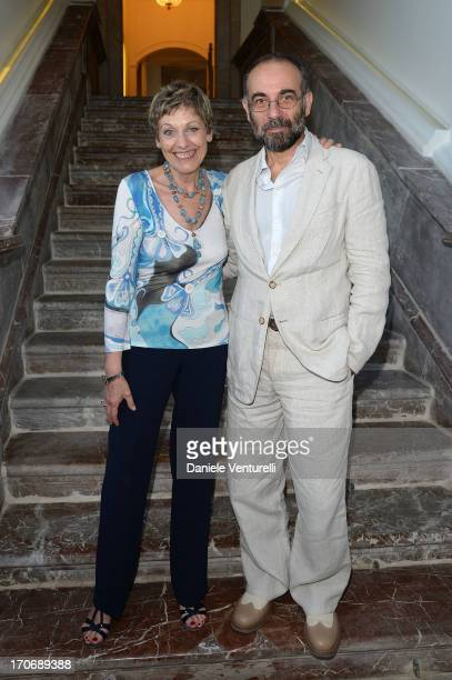 Director Giuseppe Tornatore poses with Gloria Satta at Hotel Metropole during the opening of her exhibition 'Oltre Mare' on June 16 2013 in Taormina...