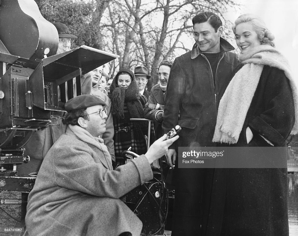 Director Gordon Parry talking to actors <a gi-track='captionPersonalityLinkClicked' href=/galleries/search?phrase=Shirley+Eaton&family=editorial&specificpeople=900615 ng-click='$event.stopPropagation()'>Shirley Eaton</a> and Ronald Lewis, on the set of the film 'Panic in the Parlour' in Rosebery Park, Epsum, Surrey, February 23rd 1956.