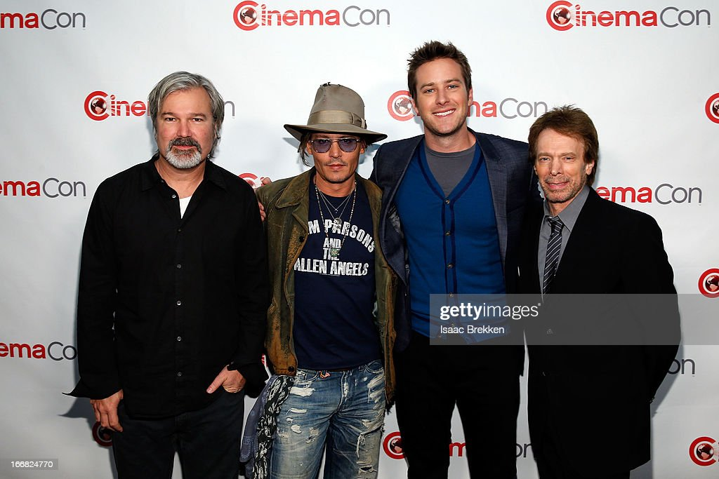 Director <a gi-track='captionPersonalityLinkClicked' href=/galleries/search?phrase=Gore+Verbinski&family=editorial&specificpeople=538751 ng-click='$event.stopPropagation()'>Gore Verbinski</a>, actor <a gi-track='captionPersonalityLinkClicked' href=/galleries/search?phrase=Johnny+Depp&family=editorial&specificpeople=202150 ng-click='$event.stopPropagation()'>Johnny Depp</a>, actor <a gi-track='captionPersonalityLinkClicked' href=/galleries/search?phrase=Armie+Hammer&family=editorial&specificpeople=5313113 ng-click='$event.stopPropagation()'>Armie Hammer</a> and producer <a gi-track='captionPersonalityLinkClicked' href=/galleries/search?phrase=Jerry+Bruckheimer&family=editorial&specificpeople=203316 ng-click='$event.stopPropagation()'>Jerry Bruckheimer</a> arrive at The Walt Disney Studios Motion Pictures presentation to promote their upcoming film, 'The Lone Ranger' at Caesars Palace during CinemaCon, the official convention of the National Association of Theatre Owners on April 17, 2013 in Las Vegas, Nevada.