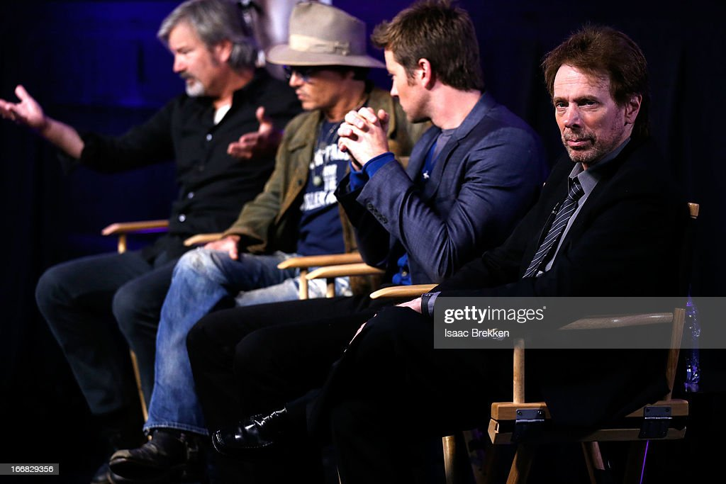 Director Gore Verbinski, actor Johnny Depp, actor Armie Hammer and producer Jerry Bruckheimer attend 'The Lone Ranger' fan event and global trailer launch at the AMC Town Square 18 theatres on April 17, 2013 in Las Vegas, Nevada.