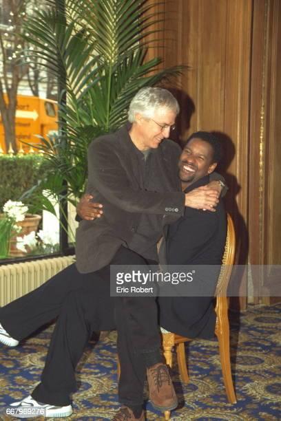 Director Gregory Hoblit sitting on Denzel Washington's lap