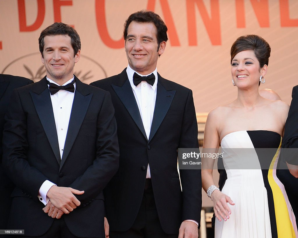 Director <a gi-track='captionPersonalityLinkClicked' href=/galleries/search?phrase=Guillaume+Canet&family=editorial&specificpeople=240267 ng-click='$event.stopPropagation()'>Guillaume Canet</a>, actor <a gi-track='captionPersonalityLinkClicked' href=/galleries/search?phrase=Clive+Owen&family=editorial&specificpeople=201515 ng-click='$event.stopPropagation()'>Clive Owen</a> and actress <a gi-track='captionPersonalityLinkClicked' href=/galleries/search?phrase=Marion+Cotillard&family=editorial&specificpeople=215303 ng-click='$event.stopPropagation()'>Marion Cotillard</a> attend the 'Blood Ties' Premiere during the 66th Annual Cannes Film Festival at Grand Theatre Lumiere on May 20, 2013 in Cannes, France.